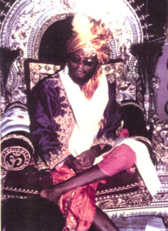 Muktananda in regal get up on a special celebration day, 1969